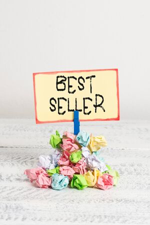 Writing note showing Best Seller. Business concept for one feature or the perceived benefit good which makes it unique Reminder pile colored crumpled paper clothespin wooden space