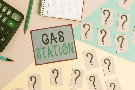 Handwriting text Gas Station. Conceptual photo for servicing motor vehicles especially with gasoline and oil Mathematics stuff and writing equipment above pastel colours background