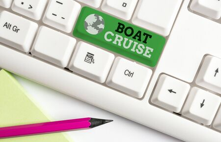 Writing note showing Boat Cruise. Business concept for sail about in area without precise destination with large ship White pc keyboard with note paper above the white background 写真素材