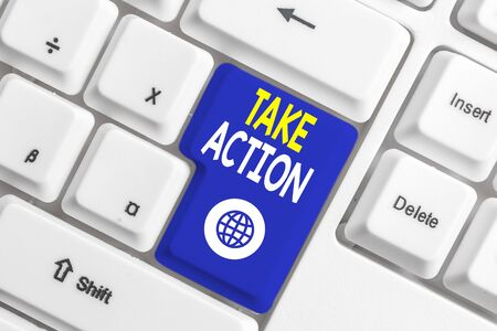Writing note showing Take Action. Business concept for Supporting what you say not just words but through evidence White pc keyboard with note paper above the white background