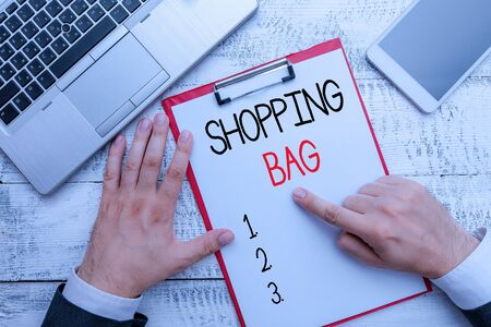Writing note showing Shopping Bag. Business concept for Containers for carrying demonstratingal possessions or purchases Foto de archivo - 130157045