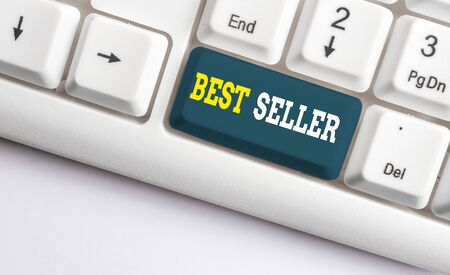 Conceptual hand writing showing Best Seller. Concept meaning one feature or the perceived benefit good which makes it unique White pc keyboard with note paper above the white background