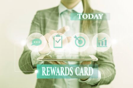 Word writing text Rewards Card. Business photo showcasing Help earn cash points miles from everyday purchase Incentives Female human wear formal work suit presenting presentation use smart device Stock Photo