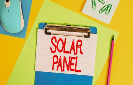 Word writing text Solar Panel. Business photo showcasing designed to absorb suns rays source of energy generating Clipboard striped sheets marker clips notepad mouse colored background