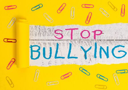 Writing note showing Stop Bullying. Business concept for Fight and Eliminate this Aggressive Unacceptable Behavior