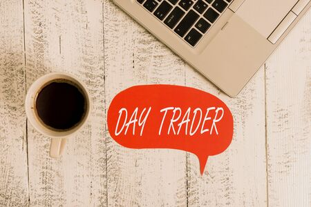 Word writing text Day Trader. Business photo showcasing A demonstrating that buy and sell financial instrument within the day Trendy metallic open laptop speech bubble vintage wooden table coffee cup
