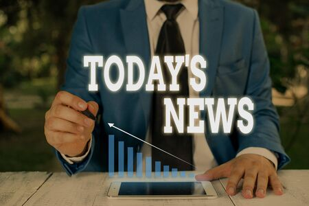 Handwriting text writing Today S News. Conceptual photo Latest Breaking Headlines Current Updates Trending Male human wear formal work suit presenting presentation using smart device Stock Photo