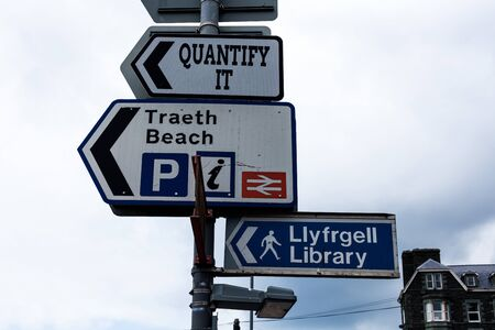 Conceptual hand writing showing Quantify It. Concept meaning Measure the size or amount of something and express in numbers Advertisement concept with empty copy space on the road sign Stock fotó
