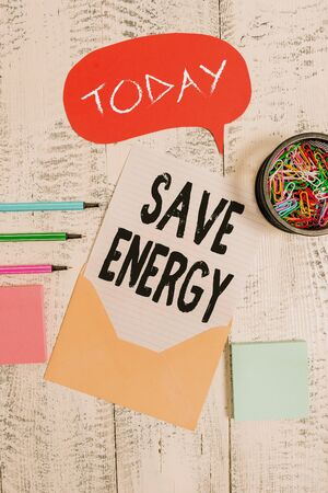 Word writing text Save Energy. Business photo showcasing decreasing the amount of power used achieving a similar outcome Envelop speech bubble paper sheet ballpoints notepads clips wooden back