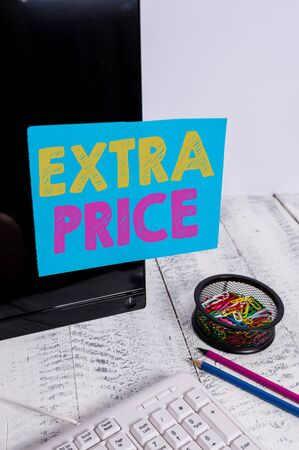 Writing note showing Extra Price. Business concept for extra price definition beyond the ordinary large degree Note paper taped to black computer screen near keyboard and stationary