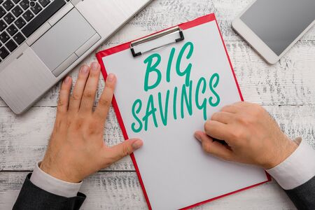 Conceptual hand writing showing Big Savings. Concept meaning income not spent or deferred consumption putting money aside