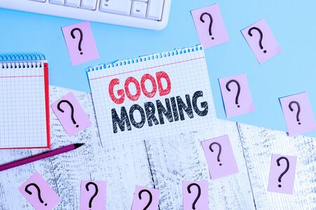 Text sign showing Good Morning. Business photo showcasing A conventional expression at meeting or parting in the morning Writing tools, computer stuff and math book sheet on top of wooden table