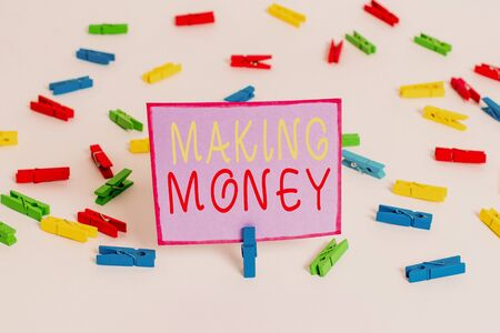 Conceptual hand writing showing Making Money. Concept meaning Giving the opportunity to make a profit Earn financial support Colored clothespin papers empty reminder white floor office