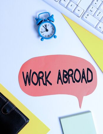 Word writing text Work Abroad. Business photo showcasing Immersed in a foreign work environment Job Overseas Non Local Flat lay with copy space on bubble paper clock and paper clips
