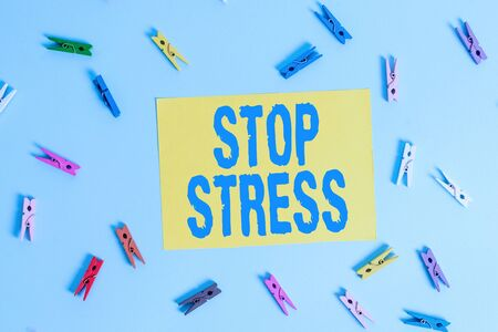Handwriting text Stop Stress. Conceptual photo Seek help Take medicines Spend time with loveones Get more sleep Colored clothespin rectangle shaped reminder paper light blue background Stock fotó