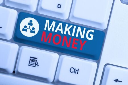 Text sign showing Making Money. Business photo showcasing Giving the opportunity to make a profit Earn financial support White pc keyboard with empty note paper above white background key copy space