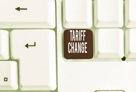 Writing note showing Tariff Change. Business concept for Amendment of Import Export taxes for goods and services White pc keyboard with note paper above the white background Фото со стока