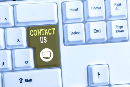 Text sign showing Contact Us. Business photo text Group of demonstrating that rendering costumer service through telecom White pc keyboard with empty note paper above white background key copy space
