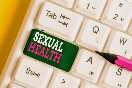 Writing note showing Sexual Health. Business concept for Healthier body Satisfying Sexual life Positive relationships White pc keyboard with note paper above the white background Фото со стока