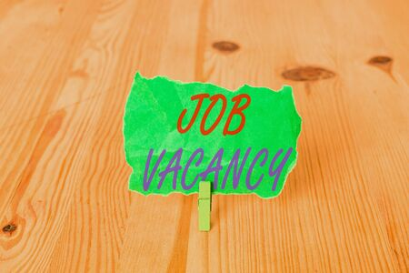 Text sign showing Job Vacancy. Business photo showcasing empty or available paid place in small or big company Empty reminder wooden floor background green clothespin groove slot office 写真素材