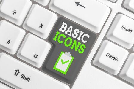 Handwriting text writing Basic Icons. Conceptual photo pictogram or ideogram displayed on a computer screen or phone White pc keyboard with empty note paper above white background key copy space