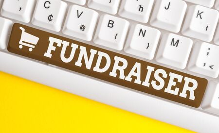 Word writing text Fundraiser. Business photo showcasing demonstrating whose job or task is seek financial support for charity White pc keyboard with empty note paper above white background key copy space