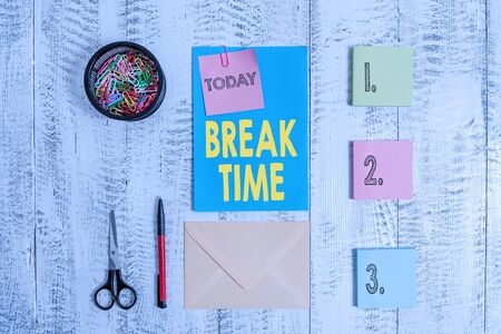 Word writing text Break Time. Business photo showcasing Period of rest or recreation after doing of certain work Envelope letter sticky note ballpoint clips can scissors wooden background Stock fotó
