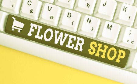 Word writing text Flower Shop. Business photo showcasing where cut flowers are sold with decorations for gifts White pc keyboard with empty note paper above white background key copy space