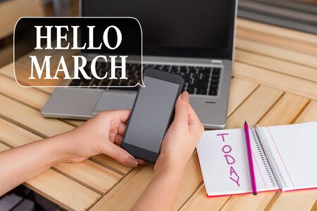Word writing text Hello March. Business photo showcasing musical composition usually in duple or quadruple with beat woman laptop computer smartphone office supplies technological devices