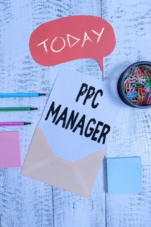 Word writing text Ppc Manager. Business photo showcasing which advertisers pay fee each time one of their ads is clicked Envelop speech bubble paper sheet ballpoints notepads clips wooden back Stock fotó