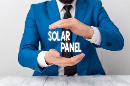 Writing note showing Solar Panel. Business concept for designed to absorb suns rays source of energy generating Man holds empty paper with copy space in front of him Space