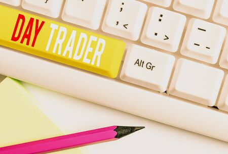 Handwriting text writing Day Trader. Conceptual photo A demonstrating that buy and sell financial instrument within the day White pc keyboard with empty note paper above white background key copy space