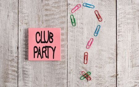 Writing note showing Club Party. Business concept for social gathering in a place that is informal and can have drinks Pastel colour note paper placed next to stationary above wooden table