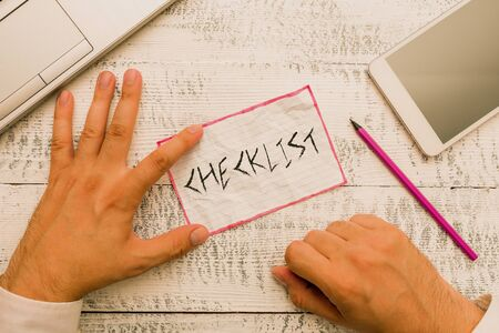 Writing note showing Checklist. Business concept for List down of the detailed activity as guide of doing something Stock Photo