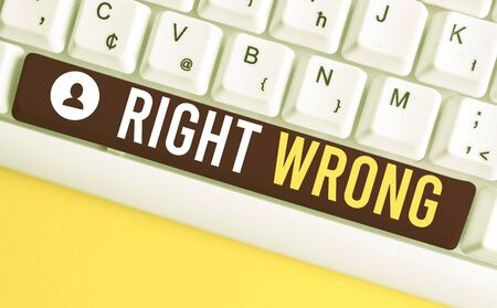 Word writing text Right Wrong. Business photo showcasing choose between two decisions correct and bad one to make White pc keyboard with empty note paper above white background key copy space Фото со стока