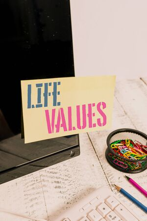 Handwriting text writing Life Values. Conceptual photo things that you believe are important in the way you live Note paper taped to black computer screen near keyboard and stationary Stock fotó