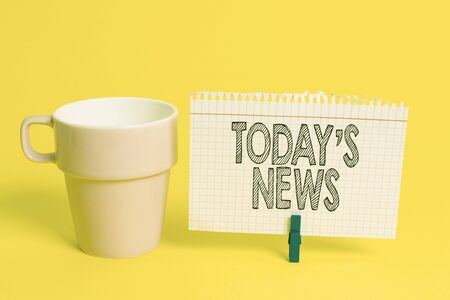 Writing note showing Today S News. Business concept for Latest Breaking Headlines Current Updates Trending Cup empty paper blue clothespin rectangle shaped reminder yellow office
