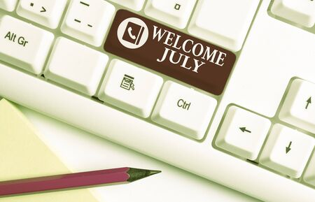 Word writing text Welcome July. Business photo showcasing Calendar Seventh Month 31days Third Quarter New Season White pc keyboard with empty note paper above white background key copy space