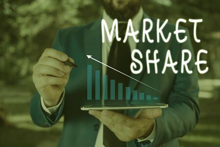 Word writing text Market Share. Business photo showcasing The portion of a market controlled by a particular company Male human wear formal work suit presenting presentation using smart device