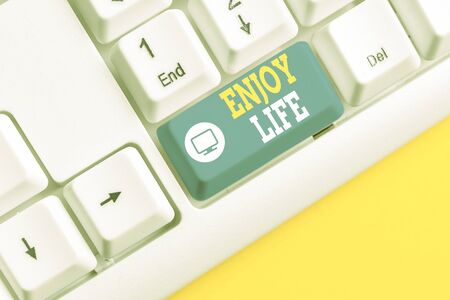 Text sign showing Enjoy Life. Business photo showcasing Any thing, place,food or demonstrating, that makes you relax and happy White pc keyboard with empty note paper above white background key copy space