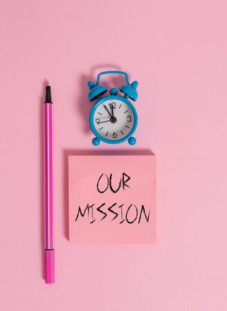 Text sign showing Our Mission. Business photo text tasks or schedule we need to made them right in order success Metal vintage alarm clock wakeup blank notepad marker colored background