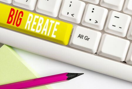Handwriting text writing Big Rebate. Conceptual photo Huge rewards that can get when you engaged to a special promo White pc keyboard with empty note paper above white background key copy space