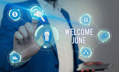 Word writing text Welcome June. Business photo showcasing Calendar Sixth Month Second Quarter Thirty days Greetings Male human wear formal work suit presenting presentation using smart device 写真素材