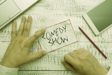 Writing note showing Comedy Show. Business concept for Funny program Humorous Amusing medium of Entertainment