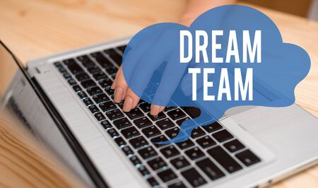 Conceptual hand writing showing Dream Team. Concept meaning Prefered unit or group that make the best out of a demonstrating woman with laptop smartphone and office supplies technology Stok Fotoğraf