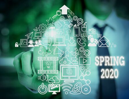 Handwriting text writing Spring 2020. Conceptual photo time of year where flowers rise following winter season Woman wear formal work suit presenting presentation using smart device