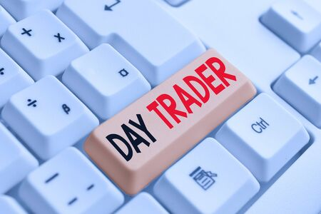 Handwriting text writing Day Trader. Conceptual photo A demonstrating that buy and sell financial instrument within the day White pc keyboard with empty note paper above white background key copy space Фото со стока