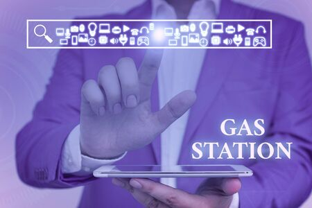 Word writing text Gas Station. Business photo showcasing for servicing motor vehicles especially with gasoline and oil Male human wear formal work suit presenting presentation using smart device