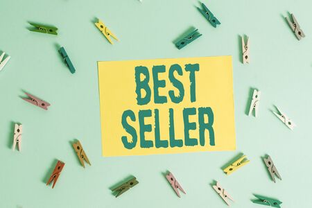 Handwriting text Best Seller. Conceptual photo one feature or the perceived benefit good which makes it unique Colored clothespin rectangle shaped reminder paper light blue background