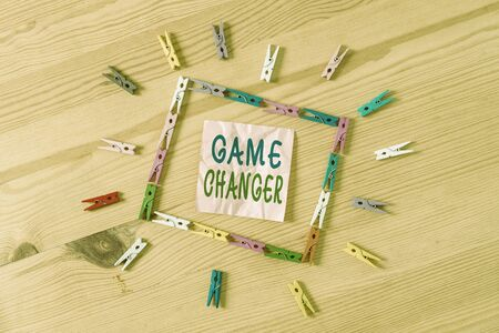 Text sign showing Game Changer. Business photo showcasing Sports Data Scorekeeper Gamestreams Live Scores Team Admins Colored clothespin papers empty reminder wooden floor background office